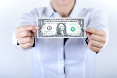 Businesswoman holding dollar banknotes isolated on a white background.Money in women`s hands. American currency. Stock Photo