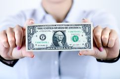 Businesswoman holding dollar banknotes isolated on a white background.Money in women`s hands. American currency. Royalty Free Stock Photography