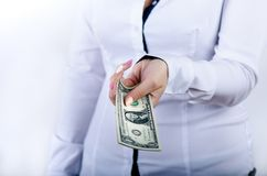 Businesswoman holding dollar banknotes isolated on a white background.Money in women`s hands. American currency. Stock Images