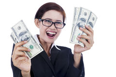 Businesswoman holding dollar bills Stock Photo