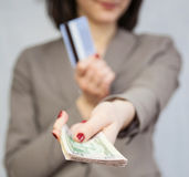 Businesswoman holding dollars and credit card Stock Photos