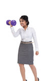 Businesswoman holding dumbbell Stock Photos