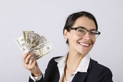 Businesswoman holding earnings Stock Images