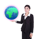 Businesswoman holding the Earth in her hand Royalty Free Stock Image