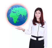 Businesswoman holding the Earth in her hand Stock Image