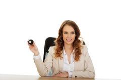 Businesswoman holding eight billiard ball. Stock Photos