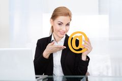 Businesswoman holding email sign Stock Photo