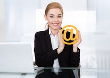 Businesswoman holding email sign Royalty Free Stock Images
