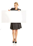 Businesswoman holding empty billboard Royalty Free Stock Photos