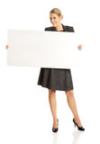 Businesswoman holding empty billboard Stock Image