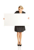 Businesswoman holding empty billboard Royalty Free Stock Images