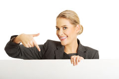Businesswoman holding empty billboard Stock Photography