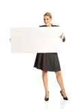 Businesswoman holding empty billboard Royalty Free Stock Photo