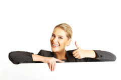 Businesswoman holding empty billboard Stock Photos
