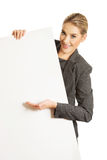 Businesswoman holding empty billboard Stock Images