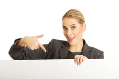 Businesswoman holding empty billboard Royalty Free Stock Image