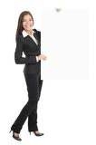 Businesswoman holding empty billboard sign royalty free stock images