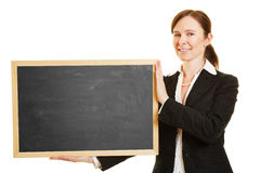 Businesswoman holding empty blackboard Stock Photo