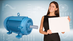 Businesswoman holding empty paper. Big blue motor Stock Photo