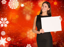 Businesswoman holding empty paper. Christmas Stock Image