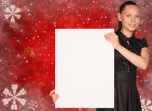 Businesswoman holding empty paper. Christmas Stock Images