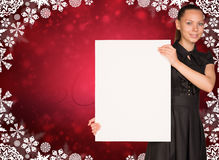Businesswoman holding empty paper. Christmas Royalty Free Stock Photography