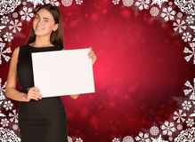 Businesswoman holding empty paper. Christmas Royalty Free Stock Photos
