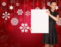 Businesswoman holding empty paper. Christmas Stock Photos