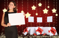 Businesswoman holding empty paper and christmas Royalty Free Stock Image