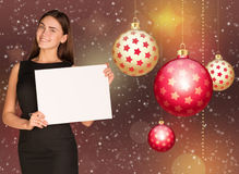 Businesswoman holding empty paper. Christmas tree Stock Images