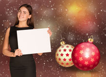 Businesswoman holding empty paper. Christmas tree Royalty Free Stock Photo