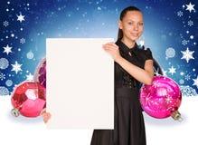 Businesswoman holding empty paper. Christmas tree Stock Image