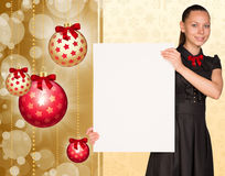 Businesswoman holding empty paper. Christmas tree Stock Photography