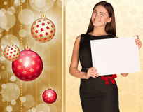 Businesswoman holding empty paper. Christmas tree Royalty Free Stock Images