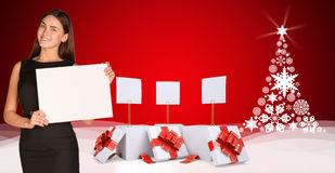 Businesswoman holding empty paper with christmas Stock Images