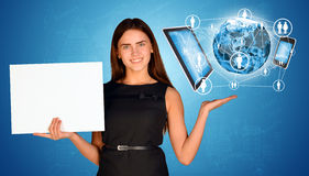 Businesswoman holding empty paper and Earth with stock images