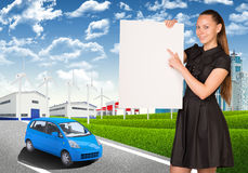 Businesswoman holding empty paper. Industrial zone Royalty Free Stock Photo