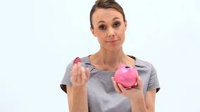 Businesswoman holding an empty piggybank stock video
