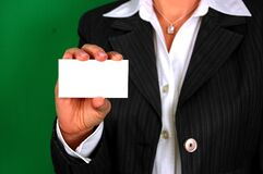 Businesswoman holding empty visiting card