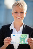 Businesswoman holding 100 euro Stock Photos