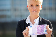 Businesswoman holding 500 euro Royalty Free Stock Image