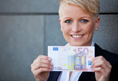 Businesswoman holding 50 Euro stock images