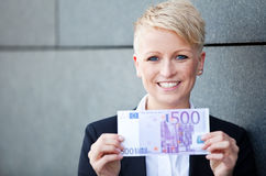 Businesswoman holding 500 euro stock images