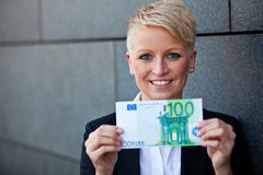 Businesswoman holding 100 euro Royalty Free Stock Photo