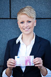 Businesswoman holding 10 Euro stock images