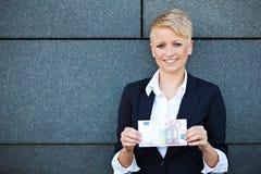Businesswoman holding 50 Euro royalty free stock image