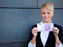 Businesswoman holding 500 euro royalty free stock image