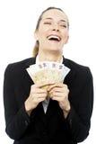 Businesswoman holding euro bills Stock Photo