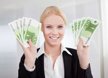 Businesswoman holding euro currency notes Stock Photo