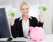 Businesswoman holding euro currency notes Royalty Free Stock Photography